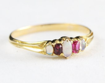 Art deco opal and ruby band ring in 18 carat gold for her