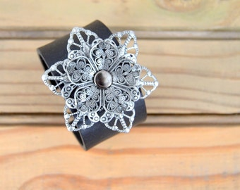Adjustable Black Cuff Bracelet with Layered Silver Metal Accent - Metal Flower