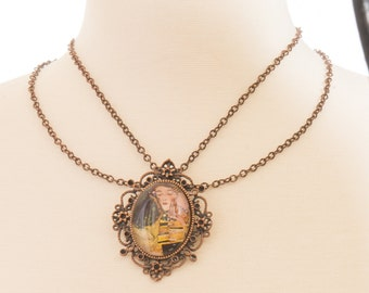 "Copper Brooch Necklace set with Klimpt's ""THE KISS"" Glass Dome Pendant & Drop Bead Back"