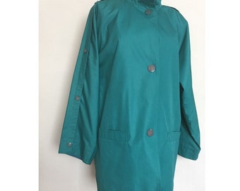 Vintage Misty Harbor teal blue mod raincoat with snap sleeves