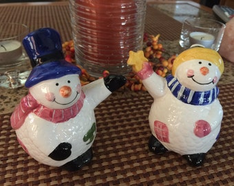 Whimsical snowman and snow woman salt and pepper shaker set