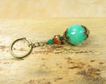 ETHNO, beaded key chain green orange, turquoise brass bronze key ring bag charms, vintage style Africa exotic hippie