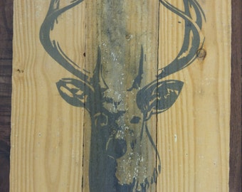 Rustic white tail deer painted on recycled wood