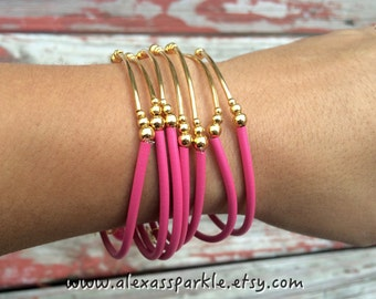 Pink Rubber Bracelet Set with gold plated charms- Semanario pulseras de caucho color rosa con dijes chapa de oro