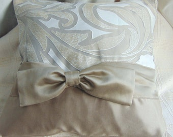 Beige pillow with bow