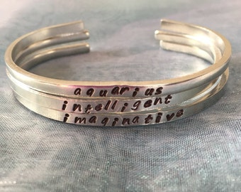 birth sign-hand stamped cuff