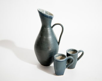 Pitcher with two mugs