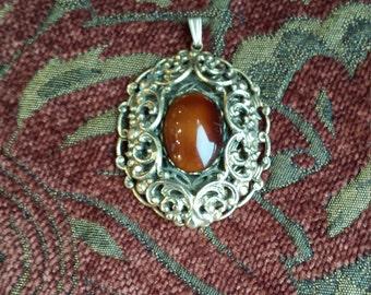Vintage gold toned pendant