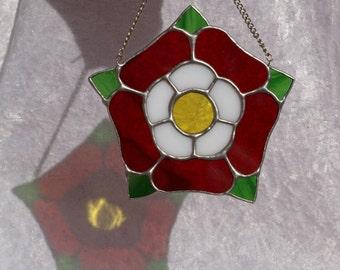 Lovely stained glass Tudor Rose flower