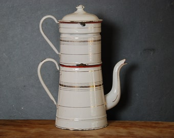 Vintage French enamelware coffee pot, jug,  with gold and red horizontal lines,  circa 1930. The coffee pot has a filter and lid.