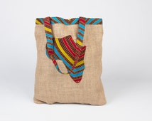 Tote bag of colorful african wax fabric full of Adinkra symbolism from Ghana by the label friendship special to give as a birthday present