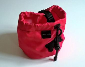 Red dog treat bag with a black bone motif