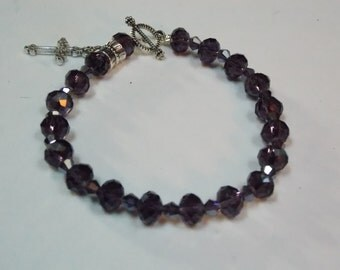 Hand made beaded bracelet w/ Purple Crystal,Silver cross