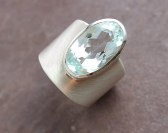 Silver ring with faceted aquamarine