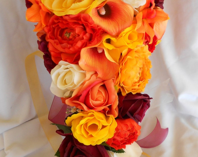 Fall cascading bridal bouquet orange, yellow, burgundy , callas, roses , rununculus, and orchids made of silk