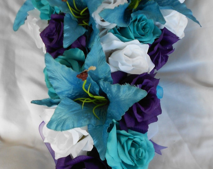 Malibu blue, turquoise and white sil cascade bouquet  Lilies and roses