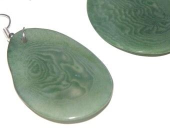 dangle drop earrings earhooks with green tagua nut slice from the rainforest ecologic fairtrade