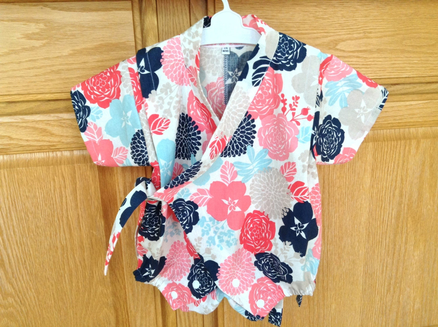 Ringer kimono style onesies w mittens are practical and comfortable - % cotton - The hospitals choice.