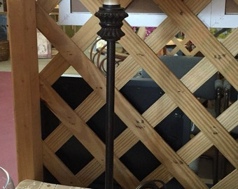 Tall black candle stick lamp eith off white shade