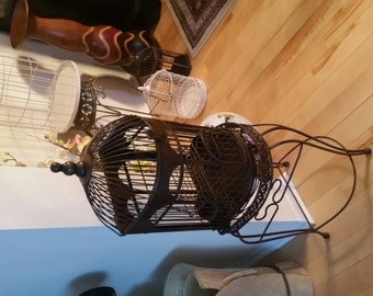 Gorgeous metal birdcage with stand.