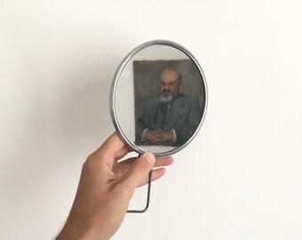 Former Barber round mirror, 1950.