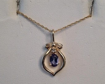 "Vintage 14k yellow gold Oval Tanzanite & Diamond Bow Topped Dangle Pendant, .49 ct on fine 18"" chain"