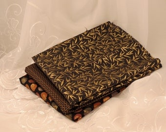 Black Fabric with Gold Accents Three Pieces 1.5 Yards Total