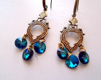 Egyptian Queen - 6 Bermuda blue Swarovski crystals on antique gold filigree findings