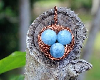 Genuine natural aquamarine birdnest pendant with copper wire wrapping