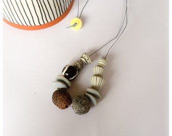 SALE - was 24.67    Handmade ceramic and stoneware beaded necklace