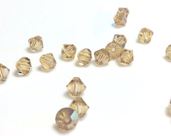 Light Colorado topaz Swarovski Crystal 5301 Bicone 6 mm beads -24 pieces