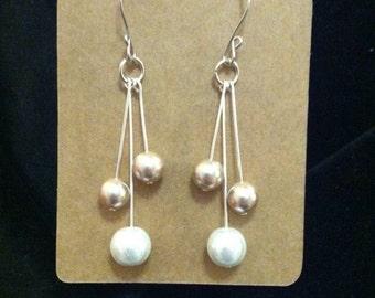 Long pearl drop earrings