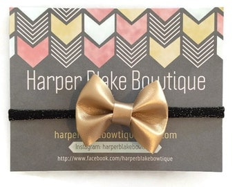 Gold Shimmer Leather Bow