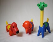 Tupperware puzzle toys animals, one giraffe, one dog and one elephant