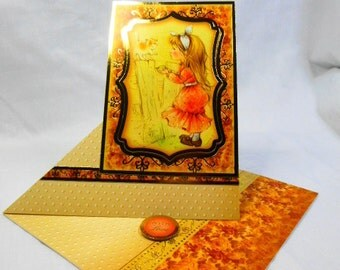 Birthday greeting card, young girl feeding a kitten, twisted easel, gold and yellow, suitable for young teen girl, Daughter, Niece, Sister