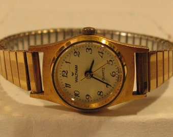 VINTAGE WALTHAM WOMAN'S Quartz Watch/Good Condition/Keeps Time/Easy to Read/Japan Movement/Made by Waltham Watch Co./Nice Watch and Rare.
