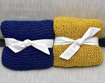 Luxurious hand-knitted throws in deep blue and rich gold