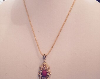 Antique pendant on silversilk chain.