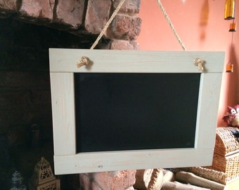 lovely rustic hanging chalkboard with wood grain coming through - light green.