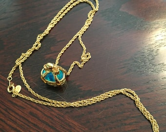 Joan Rivers Teal Egg in Gold Tone Basket Pendant Necklace