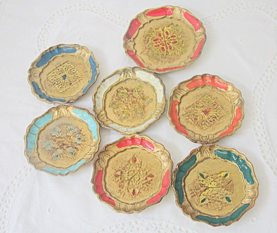 Set of Seven Small Vintage Italian Florentine Wooden Coasters, Different Colors with Gold Decor, One Larger Wine Bottle Coaster