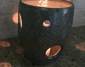 Luminary- Hand carved ceramic pottery-beautiful light patterns