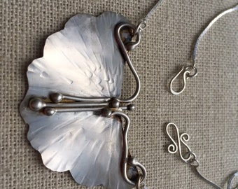Satin finish Sterling silver butterfly pendant.