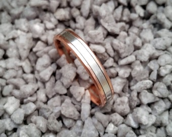 Copper ring with silver band.