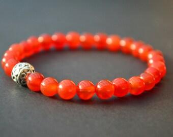 Carnelian crystal beaded bracelet with Tibetan silver feature bead