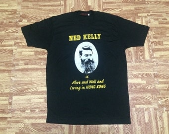 Vintage rare NOS 70s Ned Kelly last stan t shirt alive and well and living in Hong Kong medium size chest 20""