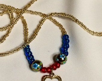 Gold, red, and blue beaded Claddagh necklace