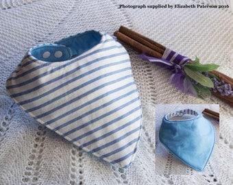 Blue striped dribble bib on blue backing