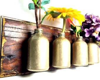 metallic gold flower vase wall mount four painted glass bottles on mahogany wood mount