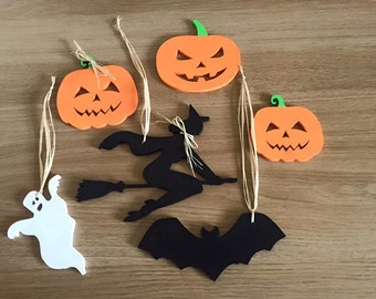 Handmade Halloween pumpkins, ghost, bat and a witch made from hard wood